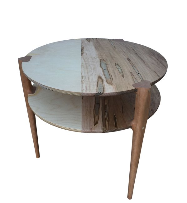 Two tier, three legged table incorporating different materials by Scott White