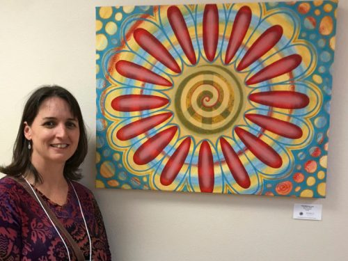 "Me with my piece, ""Find Your Shine"", at the Opening Reception at the NM Cancer Center Gallery with a Cause."